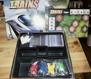 The box content: 500 cards, pieces for 4 players, station markers, a double sided map and a rule book.