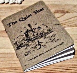 The Quiet Year - the rulebook, which strangely reminds me either of a bank book or a small notebook...