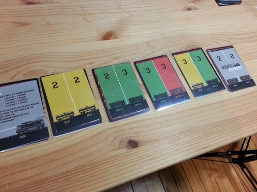 Yardmaster Express - End of game scoring would be 25 (2 X 5 cars + 3 X 5 cars). If the longest train was green, that player would get an extra 3 points